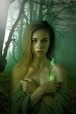 woman with glowing vial